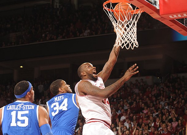 arkansas-junior-forward-marshawn-powell-dunks-the-ball-past-kentucky-guard-julius-mays-34-during-the-first-half-of-play-saturday-march-2-2013-in-bud-walton-arena-in-fayetteville