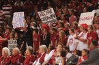 Arkansas fans hold signs directed at Little Rock native and Kentucky freshman guard Archie Goodwin during the first half of play Saturday, March 2, 2013, in Bud Walton Arena in Fayetteville.