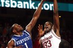 Arkansas' Marshawn Powell shoots over and is fouled by Kentucky's Darius Miller Wednesday, February 23, 2011 at Bud Walton Arena in Fayetteville.