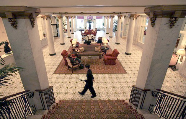 a-capital-hotel-employee-walks-through-the-ornate-lobby-area-of-the-downtown-little-rock-hotel-tuesday-afternoon-the-hotel-has-been-awarded-a-forbes-travel-guide-four-star-rating