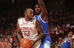 Arkansas junior forward Marshawn Powell (33) attempts to make a move around Kentucky freshman forward Alex Poythress during the first half of play Saturday, March 2, 2013, in Bud Walton Arena in Fayetteville.