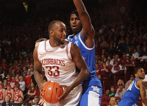 arkansas-junior-forward-marshawn-powell-33-attempts-to-make-a-move-around-kentucky-freshman-forward-alex-poythress-during-the-first-half-of-play-saturday-march-2-2013-in-bud-walton-arena-in-fayetteville