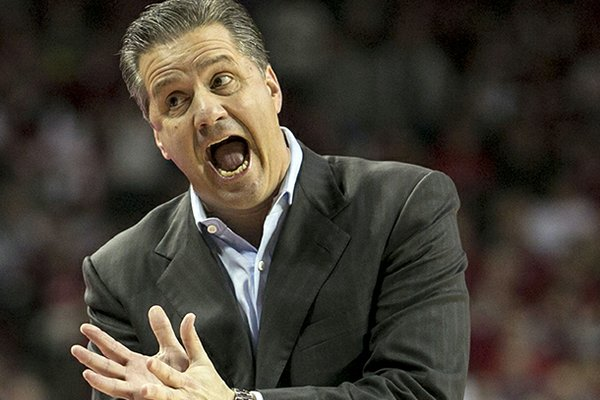 Kentucky's head coach John Calipari yells to his bench during the first half of an NCAA college basketball game against Arkansas in Fayetteville, Ark., Saturday, March 2, 2013. (AP Photo/Gareth Patterson)