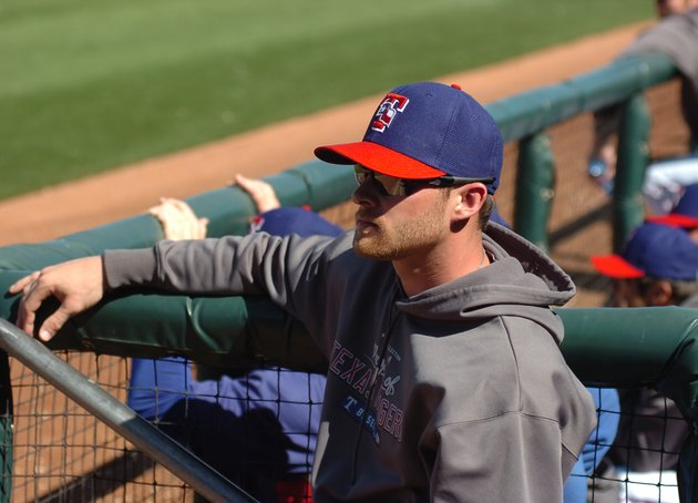 texas-rangers-outfielder-craig-gentry-watches-a-spring-training-game-from-the-dugout-on-thursday-feb-28-2013-in-surprise-ariz