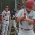 Arkansas coach Dave Van Horn watches from the dugout as outfielder Joe Serrano bats during the Razor...