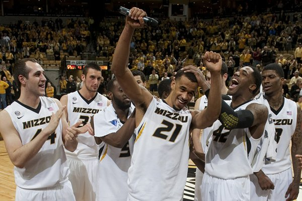Missouri's Laurence Bowers, center, gets some love from teammates before he delivers a speech to the crowd at Mizzou Arena after they defeated Arkansas in an NCAA college basketball game Tuesday, March 5, 2013, in Columbia, Mo. Missouri won the game 93-63. It was Bowers final home game as a Tiger. (AP Photo/L.G. Patterson)