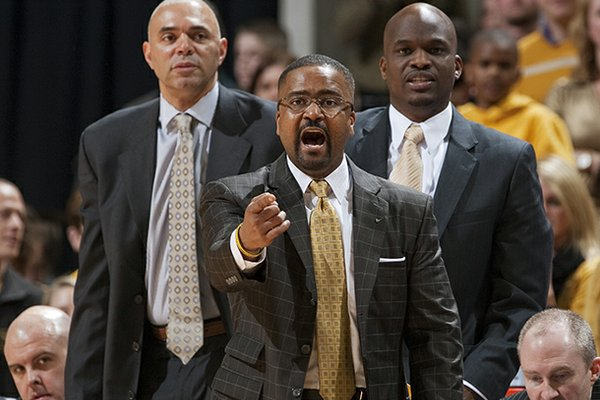 Missouri head coach Frank Haith argues a call in front of assistant coach Dave Leitao, left, and associate head coach Tim Fuller, right, during the second half of an NCAA college basketball game against Arkansas Tuesday, March 5, 2013, in Columbia, Mo. Missouri won the game 93-63. (AP Photo/L.G. Patterson)
