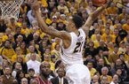Missouri forward Laurence Bowers (21) dunks over Arkansas forward Marshawn Powell (33) in the second half of an NCAA college basketball game on Tuesday, March 5, 2013, at Mizzou Arena in Columbia, Mo. (AP Photo/St. Louis Post-Dispatch, Chris Lee)