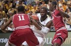 Missouri's Keion Bell, center, drives between Arkansas' BJ Young, left, and Fred Gulley, right, during the first half of an NCAA college basketball game Tuesday, March 5, 2013, in Columbia, Mo. (AP Photo/L.G. Patterson)