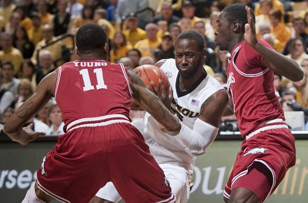 missouris-keion-bell-center-drives-between-arkansas-bj-young-left-and-fred-gulley-right-during-the-first-half-of-an-ncaa-college-basketball-game-tuesday-march-5-2013-in-columbia-mo-ap-photolg-patterson
