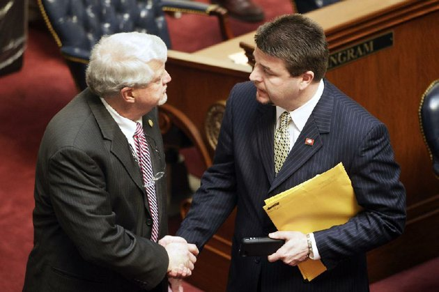 sen-jason-rapert-r-conway-right-greets-sen-bobby-j-pierce-d-sheridan-on-the-floor-of-the-senate-chamber-at-the-arkansas-state-capitol-in-little-rock-ark-tuesday-march-5-2013-pierce-voted-against-an-override-of-gov-mike-beebes-veto-of-raperts-legislation-that-would-ban-most-abortions-from-the-12th-week-of-pregnancy-onward-ap-photodanny-johnston