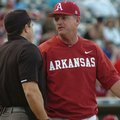 Arkansas coach Dave Van Horn argues a call with the home plate umpire during the Razorbacks' 3-1 los...