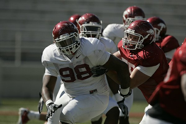 Arkansas defensive tackle Robert Thomas (98) runs a drill during a 2011 spring practice in Fayetteville.