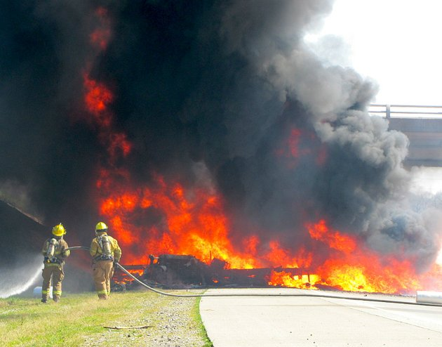 firefighters-work-to-extinguish-a-tractor-trailer-consumed-by-fire-in-a-wreck-that-shut-down-i-40-thursday