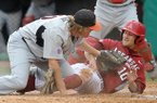 Arkansas outfielder Joe Serrano avoids the tag of San Diego State pitcher Philip Walby as he scores a run in the third inning to tie up the score 2-2 during Friday night's baseball game at Baum Stadium in Fayetteville.