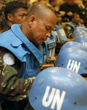 Some of the 21 Filipino U.N. peacekeepers attend a news conference Saturday in Amman, Jordan, after being released by Syrian rebels.