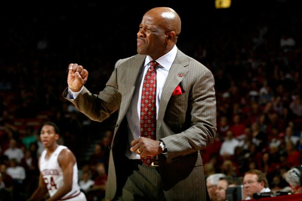 Arkansas head coach Mike Anderson signals to his players during the second half against Texas A&M on Saturday, March 9, 2013, at Bud Walton Arena.