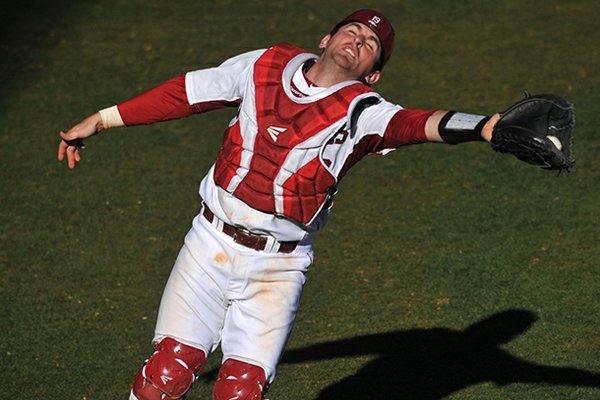 Arkansas catcher Jake Wise reaches for a foul ball during a Feb. 19 game against New Orleans at Baum Stadium.