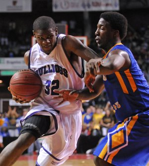 Manuale Watkins, left, of Fayetteville High School drives around Gary Vines of North Little Rock High School Saturday in the second half of the game at Barton Coliseum in Little Rock for the 7A Boys State Basketball Championship. Fayetteville lost to North Little Rock, 64-52. For more photos from on Saturday's game, visit the NWA photo blog at http://photos.nwaonline.com.