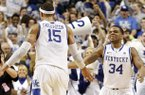 Kentucky's Willie Cauley-Stein, left, and Julius Mays celebrate after Kentucky upset No. 11 Florida 61-57 in an NCAA college basketball game at Rupp Arena in Lexington, Ky., Saturday, March 9, 2013. (AP Photo/James Crisp)