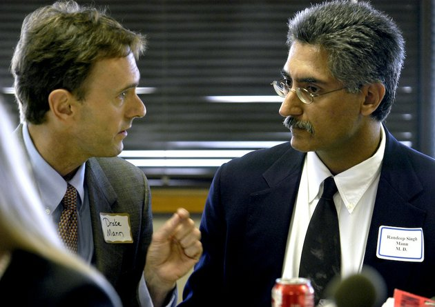 file-dr-randeep-singh-mann-r-confers-with-his-attorney-drake-mann-before-the-start-of-a-hearing-at-the-arkansas-state-medical-board-on-oct-3-2003-mann-recently-filed-an-appeal-to-have-his-case-heard-by-the-arkansas-supreme-court