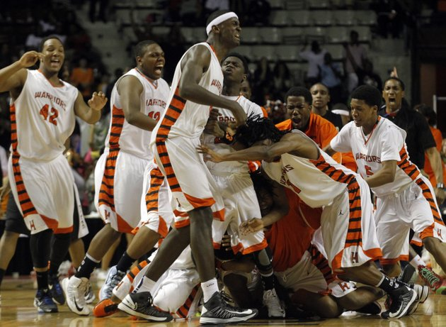 hall-teammates-celebrate-after-evan-james-made-a-last-second-basket-giving-hall-a-34-33-victory-over-jonesboro-in-the-class-6a-boys-high-school-championship-game-on-saturday
