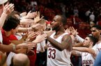 Arkansas junior Marshawn Powell and teammates celebrate with fans following their 73-62 win over Texas A&M on Saturday, March 9, 2013, at Bud Walton Arena in Fayetteville.
