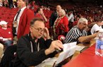 Longtime Arkansas public address announcer John George of Springdale reads pregame announcements Saturday, Feb. 16, 2013, before the start of the Hogs' game with Missouri in Bud Walton Arena in Fayetteville. George will be working the SEC Tournament for the sixth consecutive year.