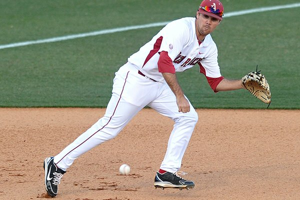 Arkansas third baseman Jacob Mahan runs down a ground ball in the first inning of Tuesday night's game against Alabama A&M at Baum Stadium in Fayetteville.