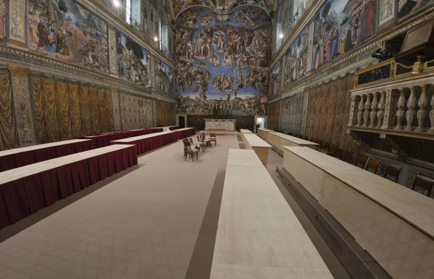 a-view-of-the-sistine-chapel-at-the-vatican-saturday-march-9-2013-firefighters-have-installed-the-top-of-the-sistine-chapel-chimney-that-will-signal-to-the-world-that-a-new-pope-has-been-elected-while-construction-workers-were-preparing-the-chapel-interior-for-the-start-of-the-papal-conclave-tuesday-for-such-an-important-decision-the-chimney-is-an-awfully-simple-affair-a-century-old-cast-iron-stove-where-ballot-papers-are-burned-with-a-copper-pipe-out-the-top-that-snakes-up-the-sistines-frescoed-walls-out-the-window-and-onto-the-chapel-roof