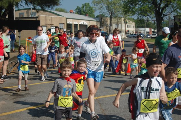 participants-take-off-during-last-years-kidsfest-superhero-race-which-benefits-the-childrens-advocacy-alliance-of-north-central-arkansas-the-event-will-be-saturday-at-the-faulkner-county-courthouse-in-conway-and-a-childrens-music-festival-and-activities-will-be-held-afterward-in-simon-park-in-downtown-conway