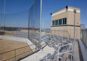 The baseball field press box and bleachers are matched by similar facilities in the adjacent softball field.
