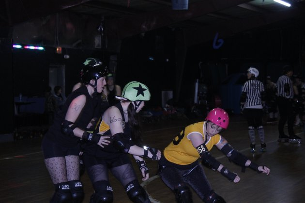 a-member-of-the-girls-rollin-in-the-south-roller-derby-league-blocks-a-fellow-skater-during-the-leagues-first-public-scrimmage-of-the-season-on-feb-26-at-the-conway-roller-rink