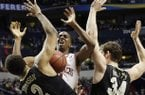 Arkansas guard BJ Young (11) works against Vanderbilt' Shelby Moats (34) and Kedren Johnson (2) during the second half of an NCAA college basketball game at the Southeastern Conference tournament, Thursday, March 14, 2013, in Nashville, Tenn. (AP Photo/Dave Martin)