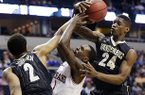 Arkansas guard Mardracus Wade (1) vies for a loose ball with Vanderbilt's Dai-Jon Parker (24) and Kedren Johnson (2) during the first half of an NCAA college basketball game at the Southeastern Conference tournament, Thursday, March 14, 2013, in Nashville, Tenn. (AP Photo/John Bazemore)