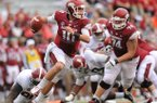 Arkansas quarterback Brandon Allen is tripped up by Alabama defensive lineman Quinton Dial during the fourth quarter of play Saturday, Sept. 15, 2012, at Razorback Stadium in Fayetteville.