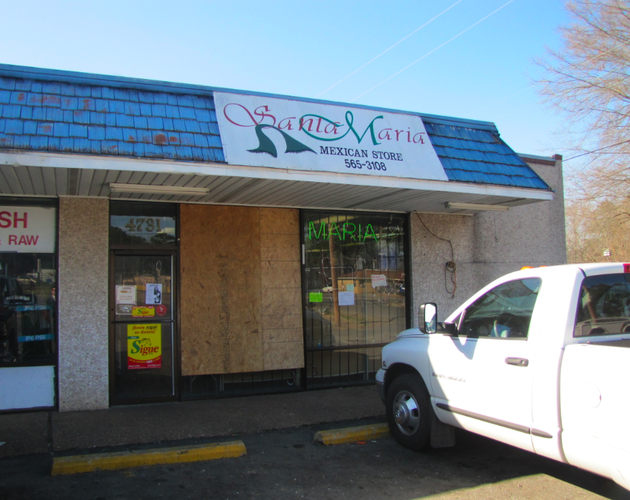 boards-cover-windows-shattered-by-gunfire-at-the-santa-maria-mexican-store-on-base-line-road-friday