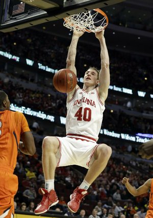 Indiana's Cody Zeller (40) dunks the ball as an Illinois defender watches during the second half of the Hoosiers' 80-64 victory over the Fighting Illini on Friday in the quarterfi nals of the Big Ten tournament at the United Center in Chicago.