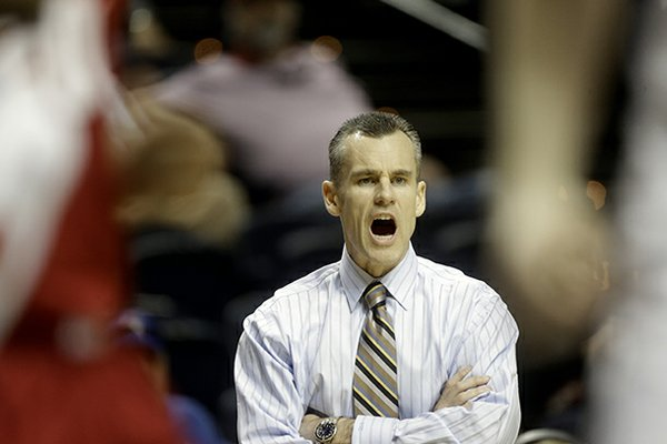 Florida head coach Billy Donovan watches play against Alabama during the first half of an NCAA college basketball game at the Southeastern Conference tournament, Saturday, March 16, 2013, in Nashville, Tenn. (AP Photo/John Bazemore)