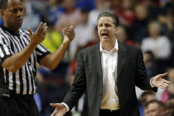 Kentucky head coach John Calipari reacts to a call during the first half of an NCAA college basketball game against the Vanderbilt at the Southeastern Conference tournament, Friday, March 15, 2013, in Nashville, Tenn. (AP Photo/Dave Martin)