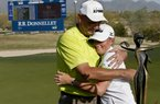 Stacy Lewis gets a hug from her father Dale after winning the LPGA Founders Cup on Sunday afternoon in Phoenix. The former Arkansas Razorback shot a 64 in the final round.