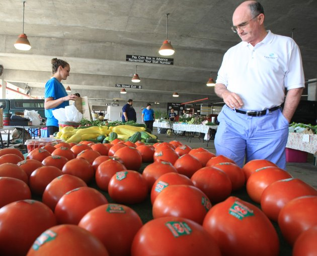 file-fred-roberson-right-buys-produce-may-26-2012-at-the-little-rock-farmers-market-from-kristi-jensen-at-ricks-farm-stand