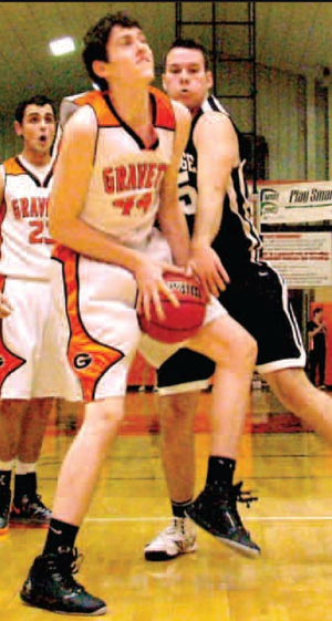 Gravette junior, Otto Troutner, grabs a rebound away from Pea Ridge forward Isaac Mangrum during play in Gravette in play this past season.
