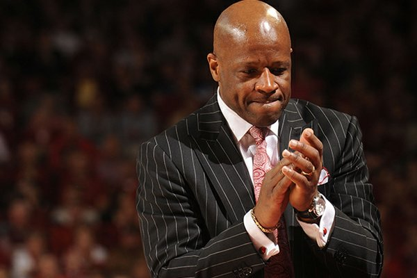 Arkansas coach Mike Anderson applauds during the second half of play against Kentucky Saturday, March 2, 2013, in Bud Walton Arena in Fayetteville.