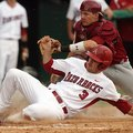 Arkansas' Jacob Mahan is tagged out at home by South Carolina catcher Grayson Greiner Sunday, May 6,...