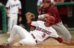 Arkansas' Jacob Mahan is tagged out at home by South Carolina catcher Grayson Greiner Sunday, May 6, 2012 at Baum Stadium in Fayetteville.