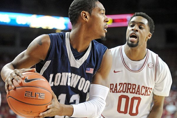 Arkansas sophomore guard Rashad Madden (00) pressures Longwood junior guard Tristan Carey on Sunday, Nov. 18, 2012, during the first half of play in Bud Walton Arena.