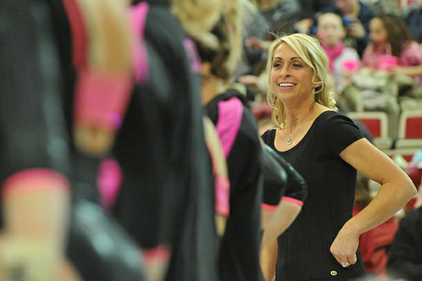 Florida gymnastics coach Rhonda Faehn watches her team during their meet against Arkansas Friday night at Barnhill Arena in Fayetteville.