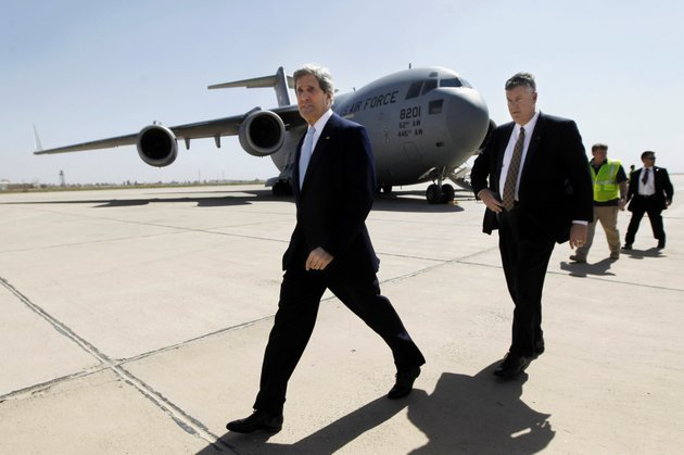 us-secretary-of-state-john-kerry-left-arrives-to-meet-with-iraqs-prime-minister-nouri-al-maliki-unseen-in-baghdad-iraq-sunday-march-24-2013-kerry-made-an-unannounced-visit-to-iraq-on-sunday-and-will-urge-al-maliki-to-make-sure-iranian-flights-over-iraq-do-not-carry-arms-and-fighters-to-syria-a-us-official-said