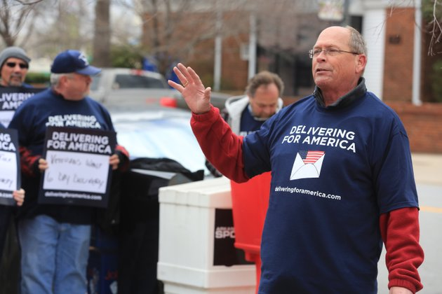 david-anderson-chair-of-the-state-association-letter-carriers-leads-letter-carriers-in-a-cheer-supporting-6-day-mail-delivery-during-a-rally-near-the-main-branch-of-the-us-post-office-in-little-rock-sunday-the-national-association-of-letter-carriers-held-a-day-of-protest-in-every-state-sunday-against-the-idea-of-ending-6-day-mail-delivery-the-us-post-office-proposes-ending-saturday-mail-delivery-the-letter-carriers-are-against-the-idea